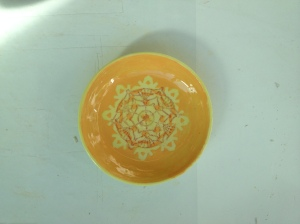 Tangerine slip, red screen printing, yellow glaze.