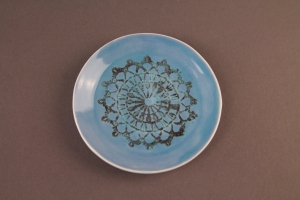 Blue Crochet Plate with paper resist and screen printing.